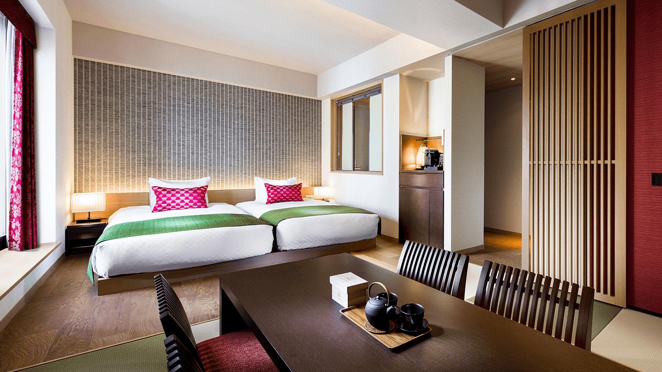畳とベッドがマッチした和洋室