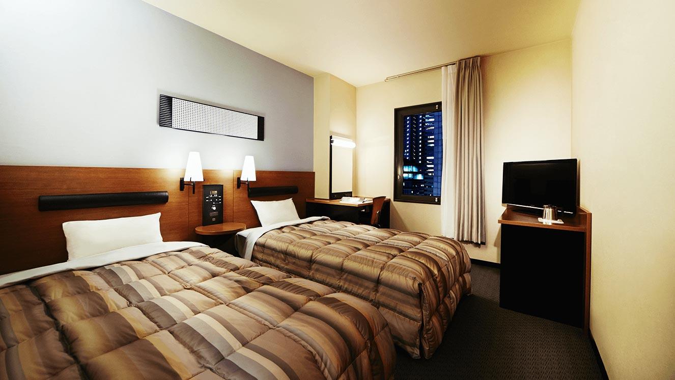 ベッド幅110cmのベッドを2台備えたツインです。