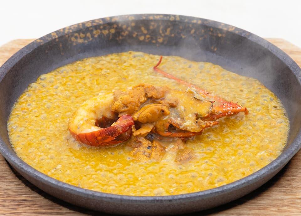 イセエビ(半身)上海蟹味噌とウニの濃厚炒めの写真