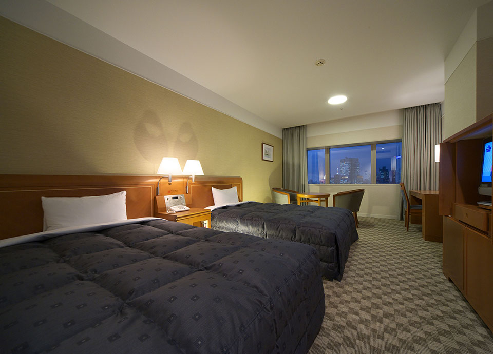 【さき得】14日前の予約でホテル最上階デラックスツインへグレードアップ